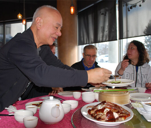 Patrick serves Peking Duck
